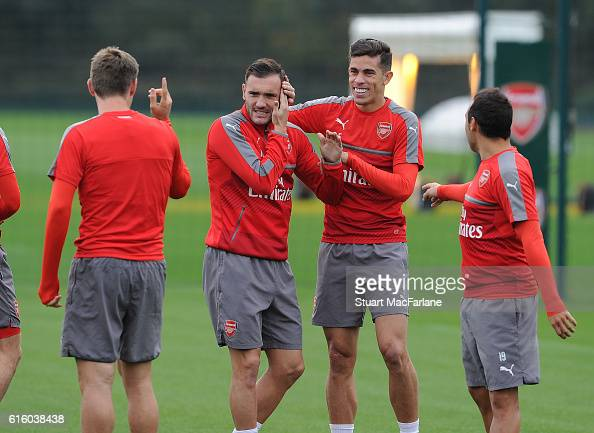 Nacho Monreal Lucas Perez Gabriel and Santi Cazorla of Arsenal joke around before a training session at London Colney on October 21 2016 in St Albans...