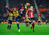 Nacho Monreal of Arsenal and James WardProwse of Southampton battle for the ball during the Barclays Premier League match between Southampton and...