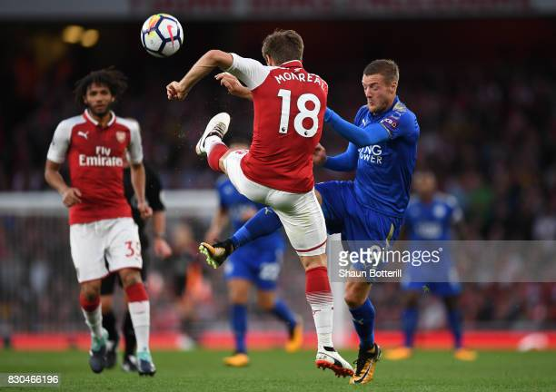 Nacho Monreal of Arsenal and Jamie Vardy of Leicester City battle for the ball during the Premier League match between Arsenal and Leicester City at...