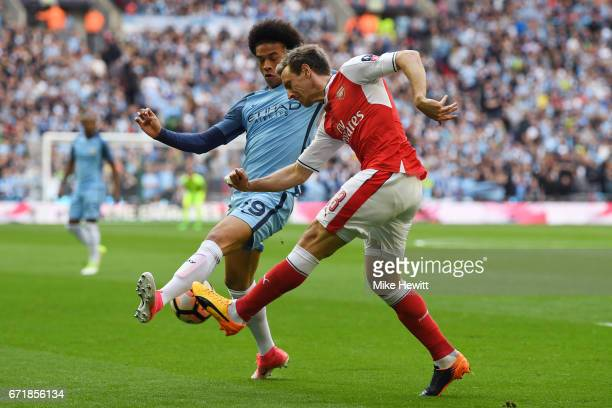 Nacho Monreal of Arsenal and Leroy Sane of Manchester City compete for the ball during the Emirates FA Cup SemiFinal match between Arsenal and...
