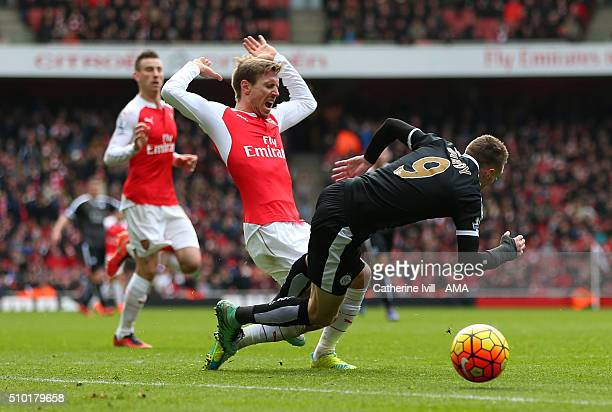 Nacho Monreal of Arsenal brings down Jamie Vardy of Leicester City in the penalty area during the Barclays Premier League match between Arsenal and...