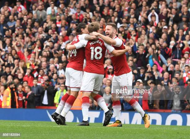 Nacho Monreal of Arsenal celebrates after scoring the opening goal with teammates Hector Bellerin and Shkodran Mustafi during the Premier League...