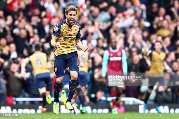 Nacho Monreal of Arsenal celebrates his team's third goal during the Barclays Premier League match between West Ham United and Arsenal at the Boleyn...