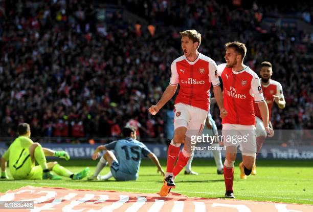Nacho Monreal of Arsenal celebrates scoring his sides first goal with his team mate Aaron Ramsey during the Emirates FA Cup SemiFinal match between...