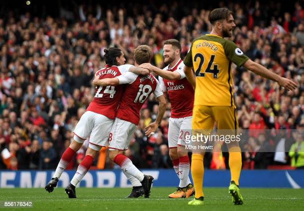 Nacho Monreal of Arsenal celebrates scoring his sides first goal with Hector Bellerin of Arsenal and Shkodran Mustafi of Arsenal during the Premier...