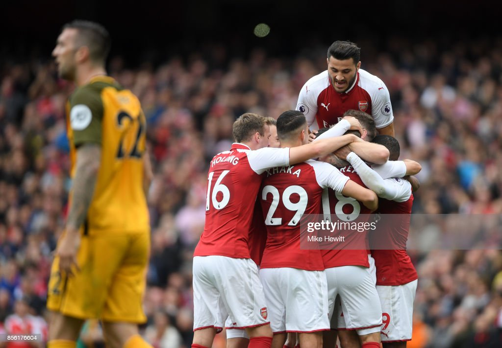 Nacho Monreal of Arsenal celebrates scoring his sides first goal with his Arsenal team mates during the Premier League match between Arsenal and Brighton and Hove Albion at Emirates Stadium on October 1, 2017 in London, England.
