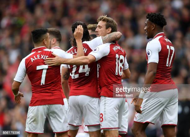 Nacho Monreal of Arsenal celebrates scoring his sides first goal with Alexis Sanchez of Arsenal and his Arsenal team mates during the Premier League...