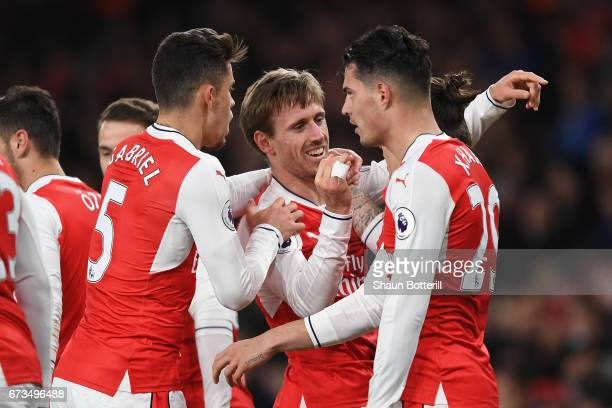 Nacho Monreal of Arsenal celebrates with team mates after his shot was deflceted onto Robert Huth of Leicester City leading to Arsenal's first goal...
