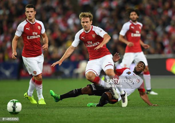 Nacho Monreal of Arsenal challenged by Abraham Majok of Western Sydney during the match between the Western Sydney Wanderers and Arsenal FC at ANZ...