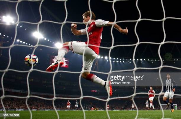 Nacho Monreal of Arsenal clears the ball from the goal line during the Premier League match between Arsenal and West Bromwich Albion at Emirates...