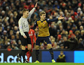 Nacho Monreal of Arsenal complains to referee Michael Jones during the Barclays Premier League match between Liverpool and Arsenal at Anfield on...