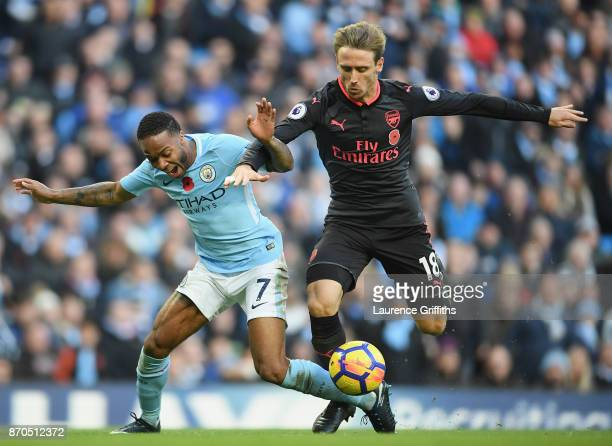 Nacho Monreal of Arsenal fouls Raheem Sterling of Manchester City and a penalty is awarded during the Premier League match between Manchester City...
