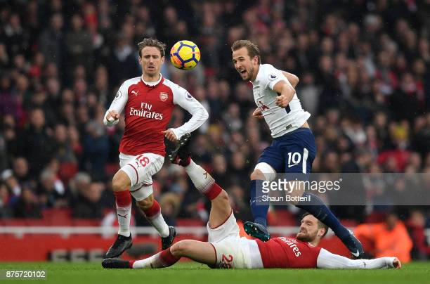 Nacho Monreal of Arsenal Harry Kane of Tottenham Hotspur and Shkodran Mustafi of Arsenal in action during the Premier League match between Arsenal...
