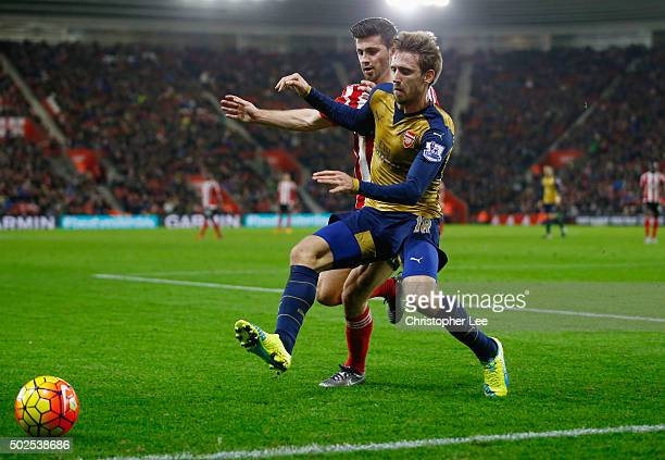 Nacho Monreal of Arsenal holds off Shane Long of Southampton during the Barclays Premier League match between Southampton and Arsenal at St Mary's...