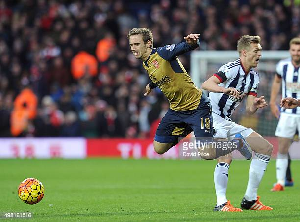 Nacho Monreal of Arsenal is tripped by Darren Fletcher of West Brom during the Barclays Premier League match between West Bromwich Albion and Arsenal...