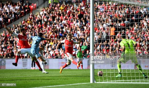Nacho Monreal of Arsenal scores his side's first goal during the Emirates FA Cup SemiFinal match between Arsenal and Manchester City at Wembley...