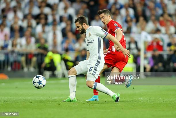 Nacho of Real Madrid and Robert Lewandowski of Bayern Muenchen battle for the ball during the UEFA Champions League Quarter Final second leg match...