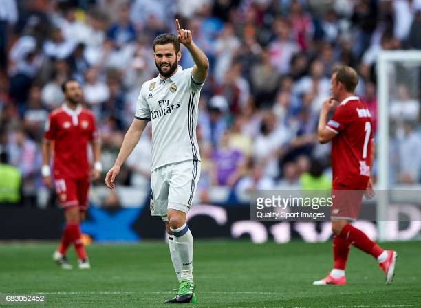 Nacho of Real Madrid celebrates after scoring the first goal during the La Liga match between Real Madrid CF and Sevilla CF at Estadio Santiago...