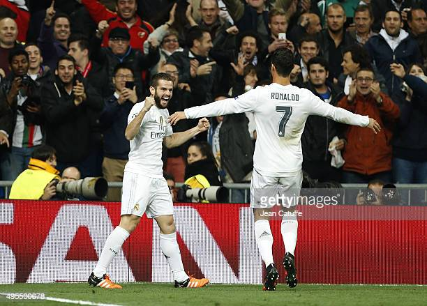 Nacho of Real Madrid celebrates his goal with Cristiano Ronaldo of Real Madrid during the UEFA Champions League match between Real Madrid and Paris...