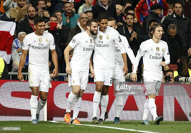 Nacho of Real Madrid celebrates his goal with Raphael Varane and teammates during the UEFA Champions League match between Real Madrid and Paris...