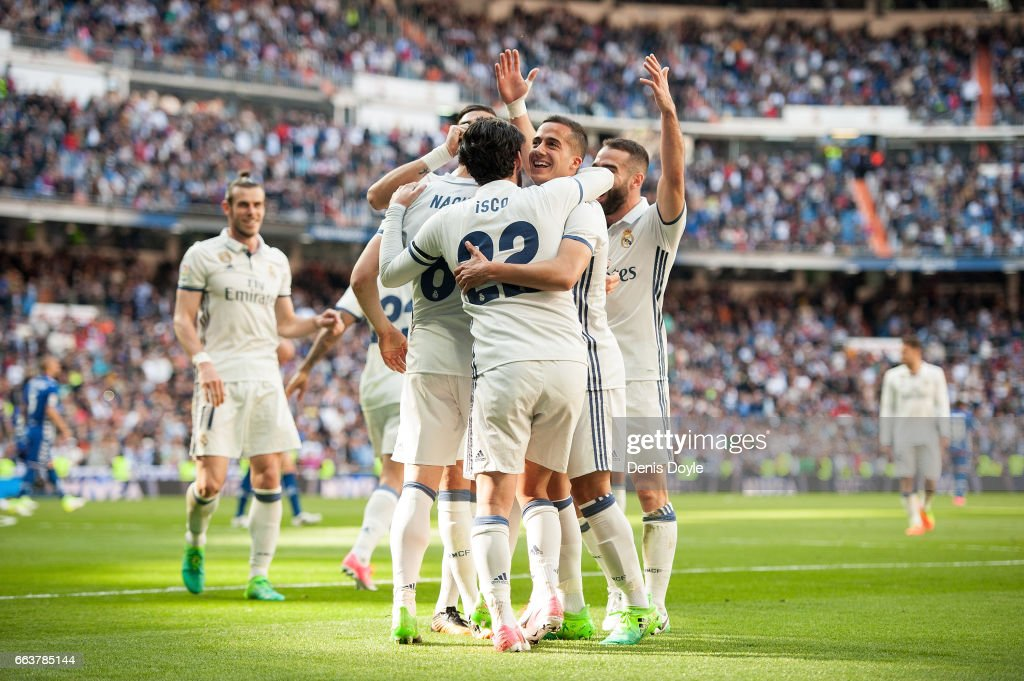 Nacho of Real Madrid celebrates with Isco Alarcon and Lucas Vazquez after scoring Real's 3rd goal during the La Liga match between Real Madrid CF and Deportivo Alaves on April 2, 2017 in Madrid, Spain.