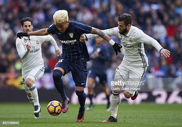 Nacho of Real Madrid competes for the ball with Adalberto Penaranda of Malaga during the La Liga match between Real Madrid CF and Malaga CF at...
