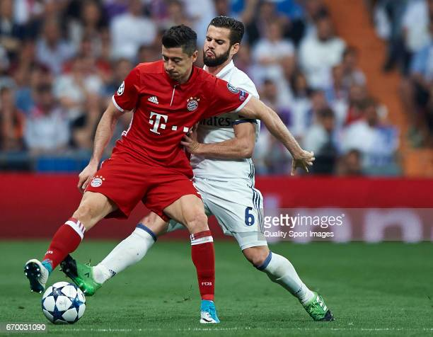 Nacho of Real Madrid competes for the ball with Robert Lewandowski of Bayern Muenchen during the UEFA Champions League Quarter Final second leg match...