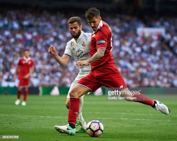 Nacho of Real Madrid competes for the ball with Stevan Jovetic of Sevilla during the La Liga match between Real Madrid CF and Sevilla CF at Estadio...