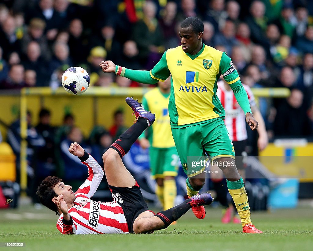 Nacho Scocco of Sunderland in action with Sebastien Bassong of Norwich during the Barclays Premier League match between Norwich City and Sunderland...
