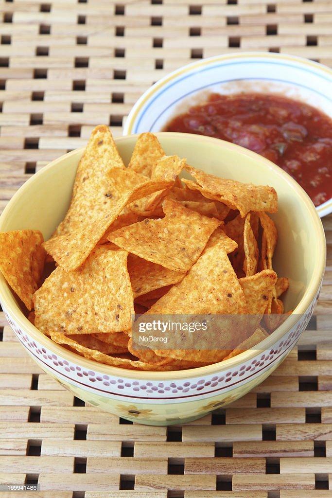 Nacho tortilla chips with salsa : Stock Photo