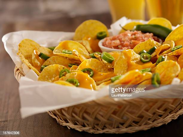 Nachos with Cheese Sauce, Jalapenos and Beers