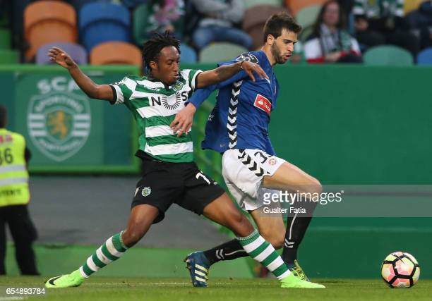 Nacional defender Rui Correia from France with Sporting CP forward Gelson Martins from Portugal in action during the Primeira Liga match between...