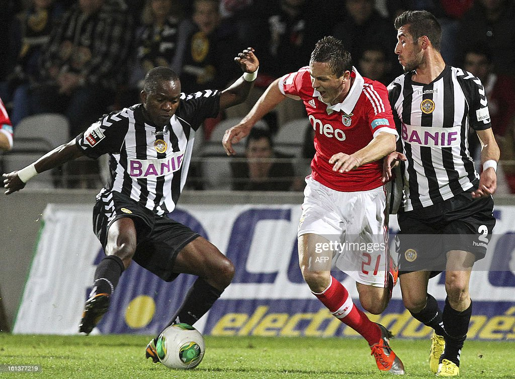 Nacional's Angolan forward Mateus (L) vies with Benfica's Serbian midfielder Matic during the Portuguese league football match Nacional vs Benfica at Madeira stadium in Funchal on February 10, 2013.