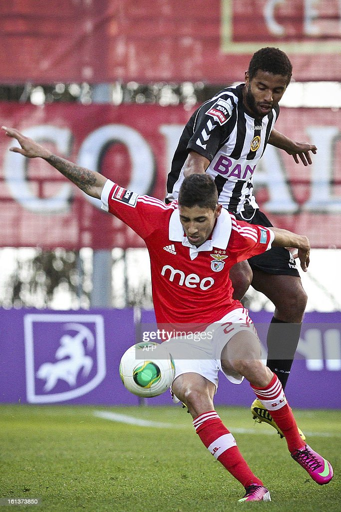 Nacional's Brazilian midfielder Diego (L) vies with Benfica's Uruguayan midfielder Urreta during the Portuguese league football match Nacional vs Benfica at Madeira stadium in Funchal on February 10, 2013.