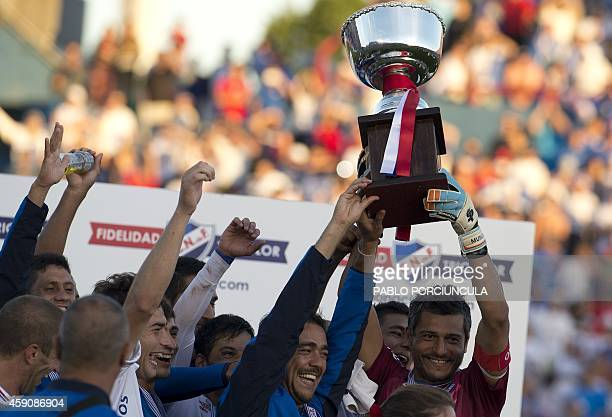 Nacional's captain Gustavo Munua and player Alvaro Recoba hold up the trophy after winning the Uruguayan first division Apertura football tournament...