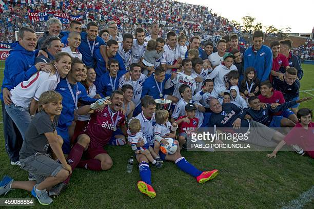 Nacional's footballers celebrate after winning the Uruguayan first division Apertura football tournament at the Gran Parque Central stadium in...