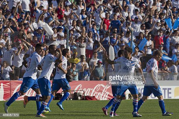 Nacional's footballers celebrate their goal against Cerro during the Uruguayan first division Apertura football tournament final match at the Gran...