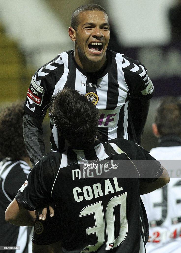 Nacional´s Mexer (top) celebrates after scoring during the Portuguese Liga football match CD Nacional vs SC Braga at Madeira Stadium in Funchal on January 12, 2013.