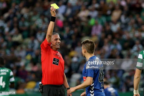 Nacionals midfielder Dejan Mezga from Croatia seeing a yellow card during Premier League 2016/17 match between Sporting CP and CD Nacional at...