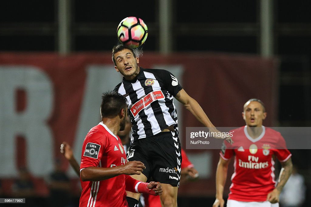 Nacional's Portuguese midfielder Vitor Goncalves in action with Benfica's Argentinian forward Toto Salvio during Premier League 2016/17 match between...