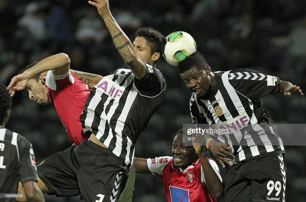 Nacional's Ruben Faria (R) heads the ball during the Portuguese Liga football match CD Nacional vs SC Braga at the Madeira Stadium in Funchal on January 12, 2013.