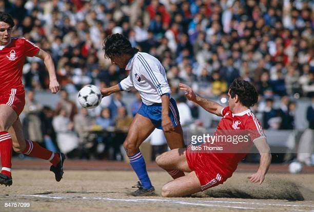 Nacional's Waldemar Victorino evades Nottingham Forest defenders Larry Lloyd and Frank Gray to score the winning goal in the World Club Championship...