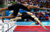 Nada Mohammed Arakji of Qatar dives off the starting blocks in the Women's 50m Freestyle heat 3 on Day 7 of the London 2012 Olympic Games at the...