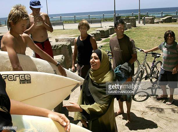 Nada Roude a representative of the Islamic Council of Australia talks to young Australian surfers at North Cronulla Beach near Sydney 15 December...