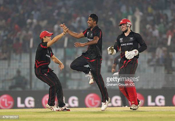 Nadeem Ahmed of Hong Kong celebrates a wicket with Mark Chapman and Jamie Atkinson during the ICC World Twenty20 match between Bangladesh and Hong...