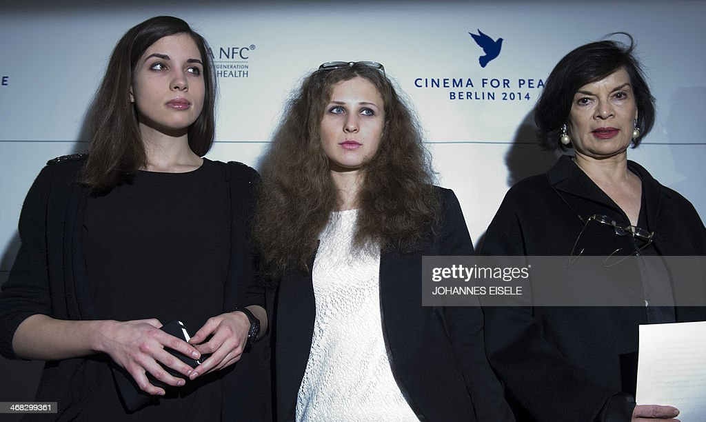 Nadezhda Tolokonnikova and Maria Alyokhina of Russian punk protest group Pussy Riot and Human Rights activist Bianca Jagger attend a press conference of the Cinema for Peace charity Gala on February 10, 2014 in Berlin. EISELE