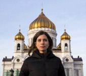 Nadezhda Tolokonnikova of Russian punk group Pussy Riot walks in front of the cathedral of Christ of Savior in Moscow on December 27 2013Two freed...