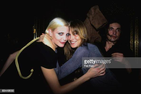 Nadia Auermann Carla Bruni and Arno Klarsfeld attend the Nadja Auermann Sushi Party at the Bains Club on October 11995 in Paris France
