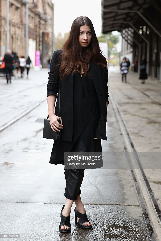 Nadia Bailey wearing Alexander Wang shoes, Vanessa Bruno pants, Claude Maus jacket, Willow dress and Dion Lee headpiece at Mercedes-Benz Fashion Week Australia 2014 at Carriageworks on April 10, 2014 in Sydney, Australia.