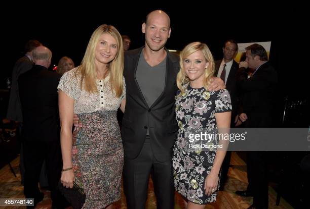 Nadia Bowers Corey Stoll and Reese Witherspoon attend 'The Good Lie' Red Carpet at The Belcourt Theatre on September 19 2014 in Nashville Tennessee